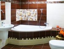 Modern designer bathroom. Elegance modern designer bathroom in brown and white hues Royalty Free Stock Photography