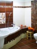 Modern designer bathroom. Elegance modern designer bathroom in brown and white hues Stock Photography