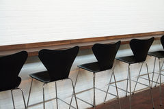 Modern designer chairs in line Royalty Free Stock Photography