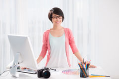 Modern designer. Copy-spaced portrait of a modern designer smiling and looking at camera on the foreground stock photos