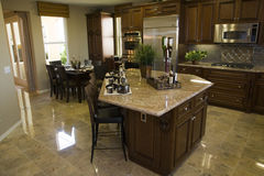 Modern designer kitchen with tiled floor. Stock Photo