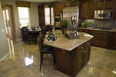 Modern designer kitchen with tiled floor. stock photo