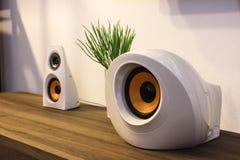 Modern designer speakers on wooden sideboard. Snapshot taken at an angle. Universal interior design Royalty Free Stock Photo