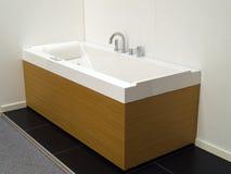Modern desiign Bathtub jacuzzi bathroom. Modern trendy desiign white and wooden frame  Bathtub jacuzzi bathroom Stock Photos