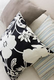 Modern desing pillows on a couch. Arrangement of modern desing pillows on a couch Stock Photo