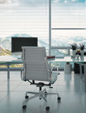 Modern desk and armchair against huge window Royalty Free Stock Images