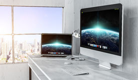 Modern desktop interior with computer and devices 3D rendering Stock Photo