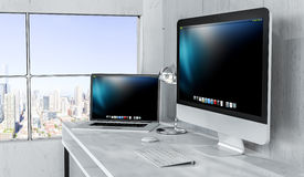 Modern desktop interior with computer and devices 3D rendering Stock Image