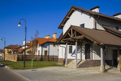 Modern detached family houses at street Royalty Free Stock Photography