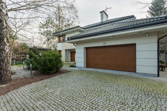 Modern detached house with garage Royalty Free Stock Image