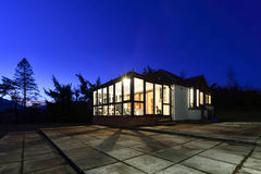 Real estate. Modern detached house photographed at blue hour, just after sunset Stock Images