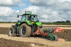 Modern deutz fahr tractor pulling a plough Stock Photography