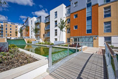 Modern development with water feature. Contemporary development with water feature and landscaped gardens royalty free stock image