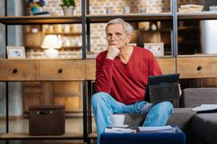 Nice thoughtful man holding a tablet Royalty Free Stock Photo