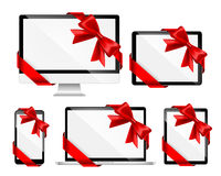 Modern devices with red bows Royalty Free Stock Photography