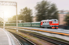 Modern diesel train with a passenger train departs from the station. Stock Image