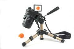 Modern digital camera on a mini tripod Stock Photos
