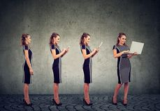 Modern digital devices and technology progress concept. Business woman using mobile phone, tablet and laptop computer Royalty Free Stock Images