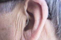Hearing aid in ear Royalty Free Stock Image
