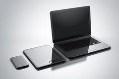 Modern digital gadgets smartphone tablet notebook Stock Image