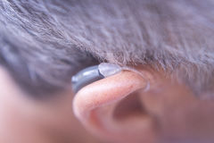 Modern digital hearing aid Stock Photo