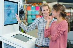 Modern digital help point in warehouse Stock Image