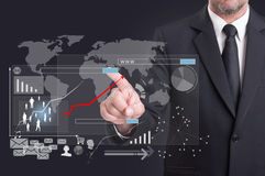 Modern digital icon on virtual screen touched by businessman Stock Photo