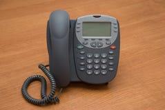 Modern digital IP phone. Modern digital phone on the table Stock Image