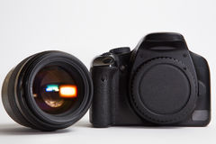 Modern digital photo camera with 85 mm photo lens Stock Photography