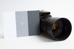 Modern digital photo camera with 85 mm photo lens Royalty Free Stock Images