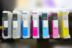 Modern digital printing press. Concept, closeup of the toner cartridges on large plotter printer stock photo