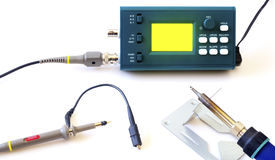 Modern digital signal oscilloscope and tools isolated on white background Royalty Free Stock Photography