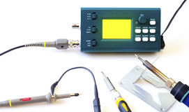 Modern digital signal oscilloscope and tools isolated on white background Stock Photography