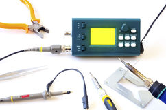 Modern digital signal oscilloscope and tools isolated on white background Stock Photo