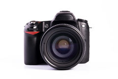 Modern digital SLR Camera. A modern generic digital SLR camera with clipping path royalty free stock images