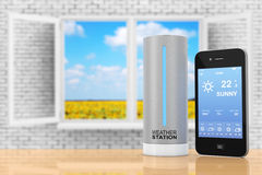 Modern Digital Wireless Home Weather Station with Mobile Phone w Stock Photography