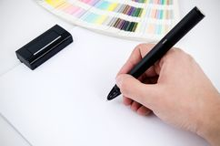 Modern digitized pen and color card in background. Graphic designer working with modern digitized pen Royalty Free Illustration