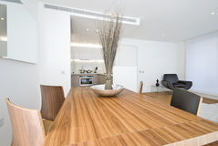 Modern dining area with wooden table Stock Photo