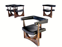 Modern Dining Chairs. Four modern chairs made from lether and metal Stock Photos