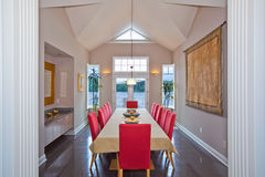 Modern Dining Room. Dining room with view and red chairs Stock Image