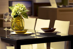 Modern dining room. With table and flowers Royalty Free Stock Photos