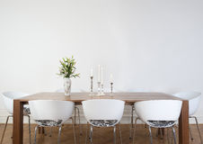 Modern dining room. Modern l´dining room with white chairs and white wall