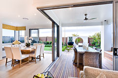 Modern dining room attached to outside patio area Stock Photography
