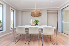 Modern dining room design with table set up and natural decorati Royalty Free Stock Photos