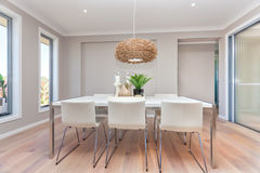 Modern dining room design with table set up and natural decorati Stock Images