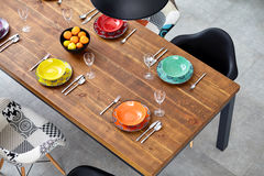 Modern dining room with dining table. Small depth of field Stock Photos
