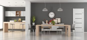 Modern dining room with kitchen Royalty Free Stock Image