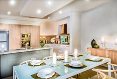 Modern dining room and the kitchen stock images
