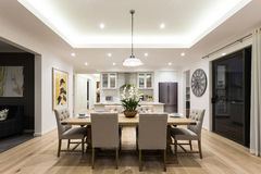 Modern dining room beside the kitchen ready to serve Stock Photography