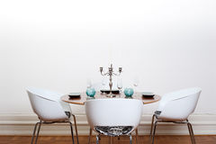 Modern dining room - round table Royalty Free Stock Photography